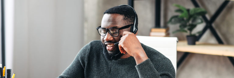 User talking on a H20 headset from Sangoma - Working From Home, Remotely