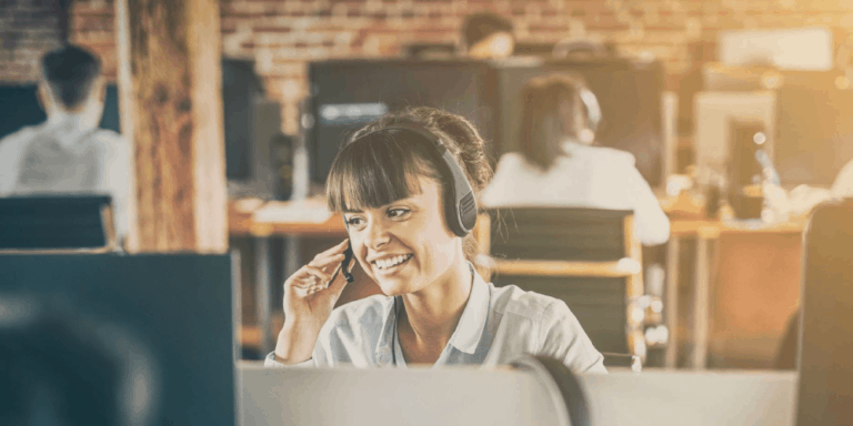 woman at computer with phone headset