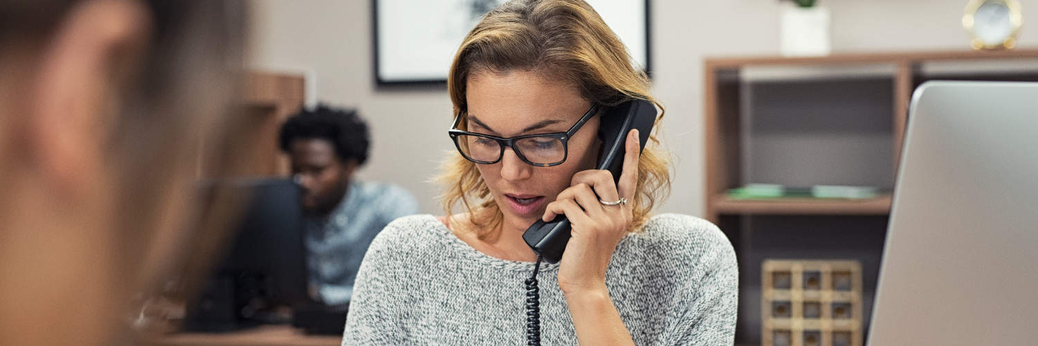 A Woman Speaking to a Customer about Unified Communications