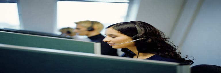 woman at call center wearing headset
