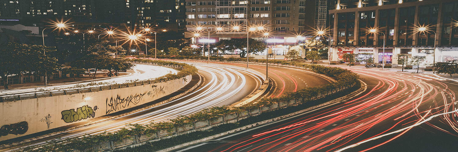 timelapse of vehicles on curved city road