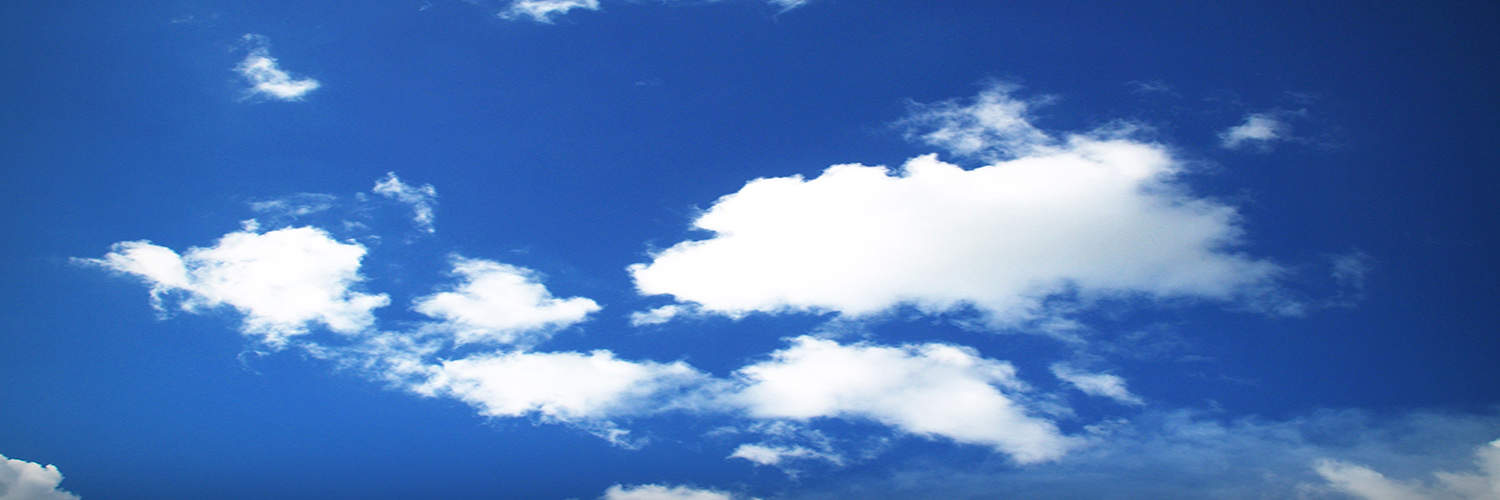 clouds floating across blue sky